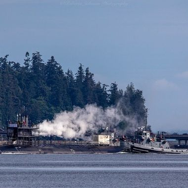 A submarine being transported from one location to another. Hood Canal, Washington, USA