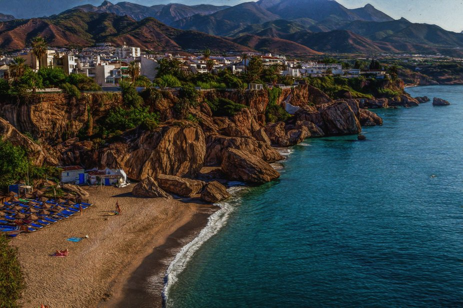 The beautiful town of Nerja in Andalucia, Spain. The Sea, beaches, white houses, mountains...