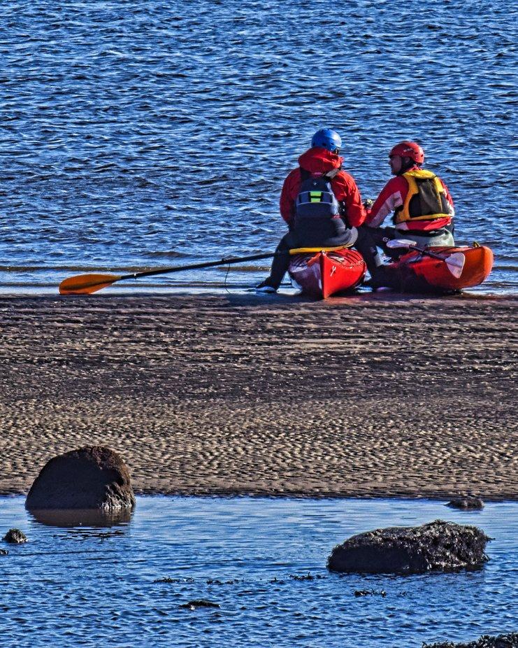 Kayak's taking a break on a sandbar.