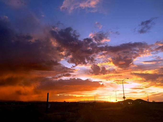 I took this with my phone because the batteries died on my camera.  My phone and sometimes even my camera does not do the sunsets here justice.  I think New Mexico is known for their sunsets and for good reason.