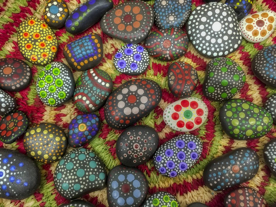 Traditional Aboriginal art patterns painted on river stones and pebbles