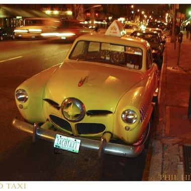 Old Studebaker in New York City parked outside a Taco Stand