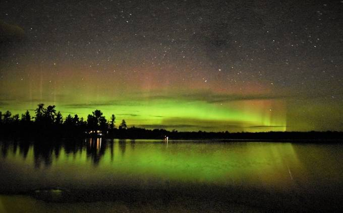 Panorama of Northern light at the cabin! Merged two photos together.