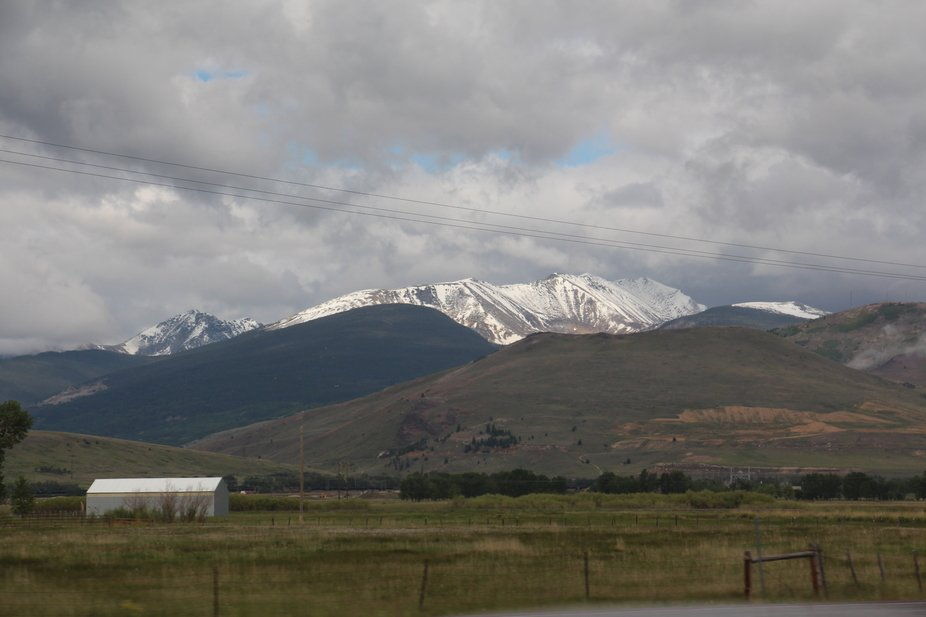 Snow abounds on the mountain tops in June.