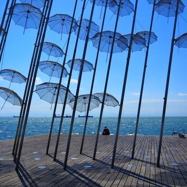 Umbrellas.  One of the most photographed spots in Thessaloniki, it acompanies walkers and bike-riders throughout their everyday strolls alongside the waterfront.