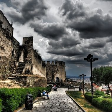 """Thessaloniki is one of those cities that has a lot to offer since it is both a modern city and an historical one. Like most places in Greece, it is an historical city with landmarks dating to ancient times. The Castle of Thessaloniki is one of those landmarks that people enjoy seeing. It is located in the Ano Poli, or the area known as the """"Upper Town"""", which is the highest part of the city. You can easily walk through the streets in the upper town and visit the various landmarks like the castle, browse in the shops, and eat a great meal."""