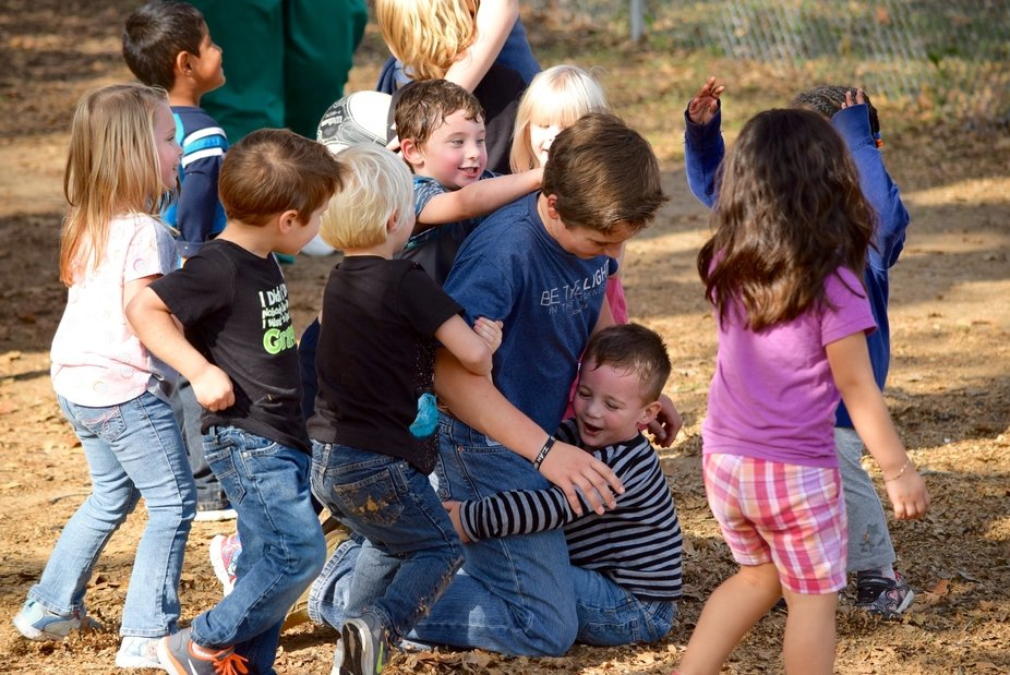 My student let himself get caught by the children who were chasing him. They gloried in bringing ...