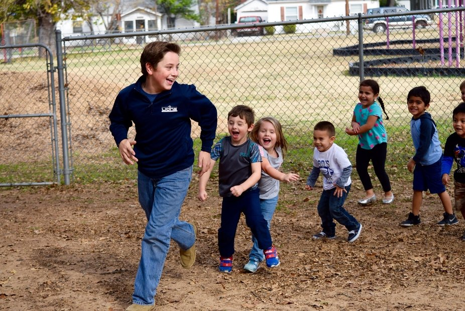 Volunteering at a local Head Start program, my student led the children on a joyful chase around ...