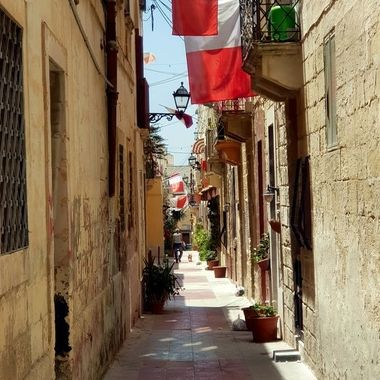 Residens display Maltese flag as a sign of solidarity against the Covid-19 pandemic