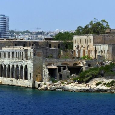 In 1592, a lazaretto made of wooden huts was built on Manoel Island in Malta during a plague epidemic. It was pulled down in 1593 after the disease had subsided. In 1643, Grandmaster Lascaris built a permanent Lazzaretto in the same place to control the periodic influx of plague and cholera on board visiting ships. The hospital was subsequently improved over time, and was enlarged during the governorship of Sir Henry Bouverie in 1837 and 1838. The hospital was closed in 1929 and building still exists to this day.  During World War II between 1941 and 1942, it was used as a submarine depot, and the buildings were bombed a number of times by Italian or German aircraft.