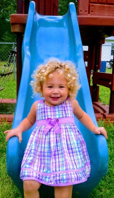 Catie grace out in the summer sun on her slide!!