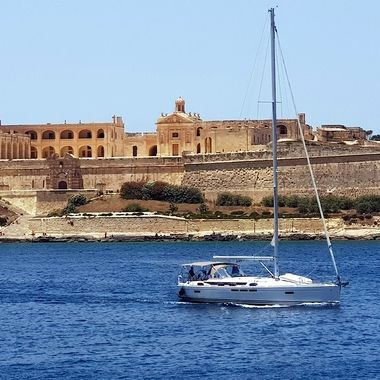 Forti Manoel or Fortizza Manoel) is a star fort on Manoel Island in Gżira, Malta. It was built in the 18th century by the Order of Saint John, during the reign of Grand Master António Manoel de Vilhena, after whom it is named. Fort Manoel is located to the north west of Valletta, and commands Marsamxett Harbour and the anchorage of Sliema Creek. The fort is an example of Baroque architecture, and it was designed with both functionality and aesthetics in mind.  After a brief French occupation which began in 1798, the British military took over the fort in 1800, when it became known as HMS Phoenicia, and it remained in use by them until 1964. The fort was severely damaged in World War II, but it was restored in the early 21st century and it is now in good condition.