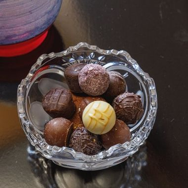 Traditional homemade chocolate truffles in a crystal bowl