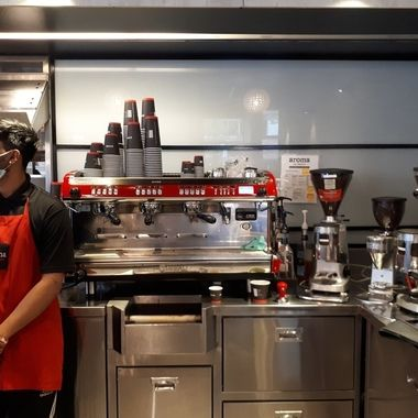 I liked how the coffee shop's employee's red apron matched the red on the coffee/espresso machine. Asked him if he would pose next to the machine and he agreed. I also asked him to look outside the window. I did this to minimize my presence and highlight the color red.