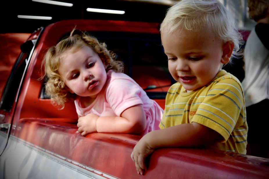 """My son and his """"first love"""" hanging out in the back of a pickup truck."""