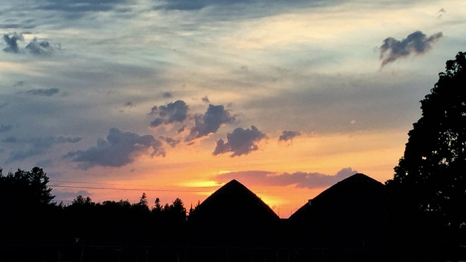 Taken on my way out from work one evening. The silhouette of the trees and salt storage was too m...