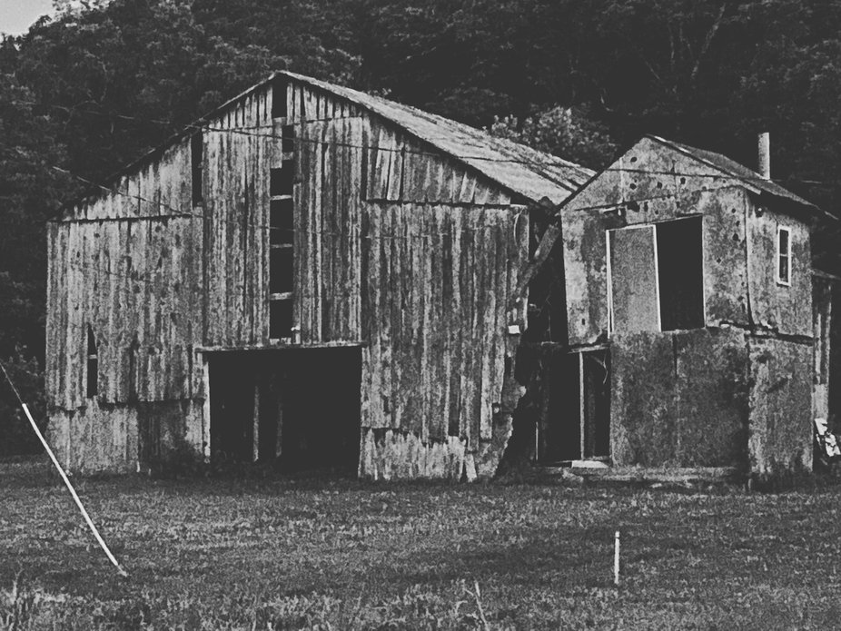 I took this picture while visiting my parents farm.  This is one of three barns on the property a...