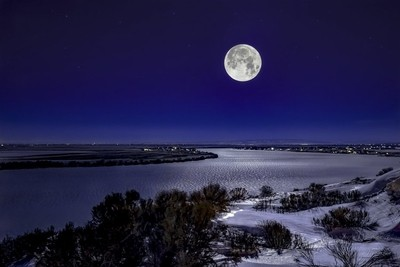 Full moon over frozen Moses Lake.
