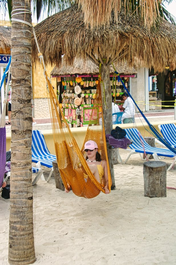 Umbrella's made from palm trees on beach at Cozumel.