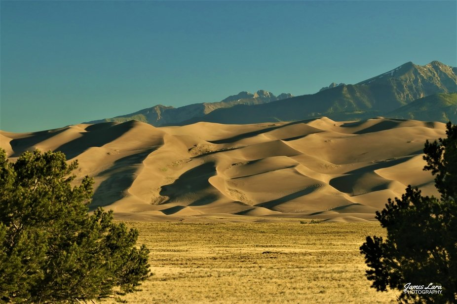 The Great Sand Dunes are located NE of Alamosa Colorado (USA).  The highest dune resides at 750 f...