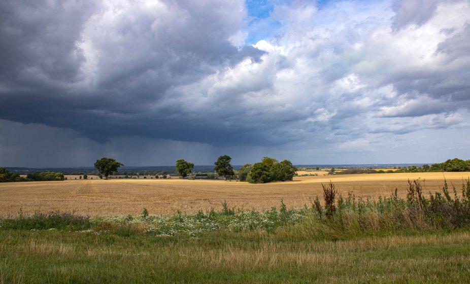 Farm fields and cloudscape, England