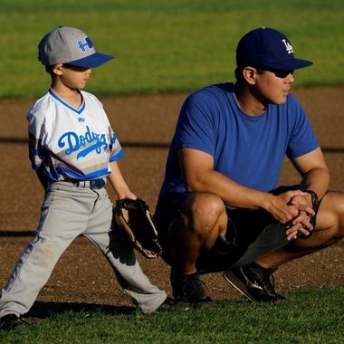 Father and son waiting for the pitch.