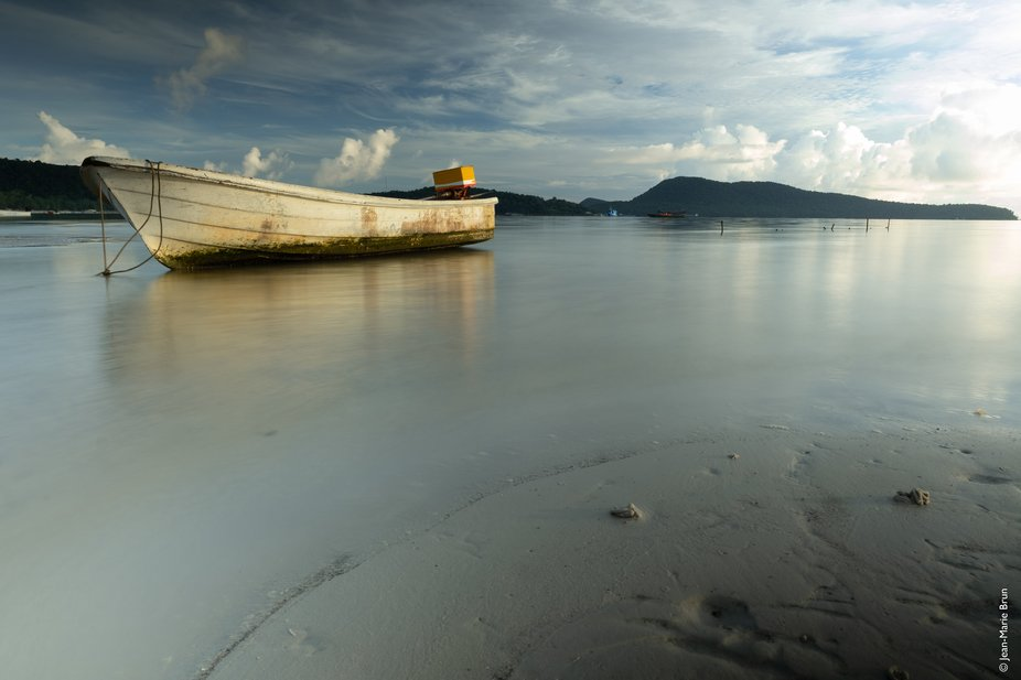 A small boat anchored on the beach of Koh Rong Samloem (Cambodia), early morning, at low tide. (L...