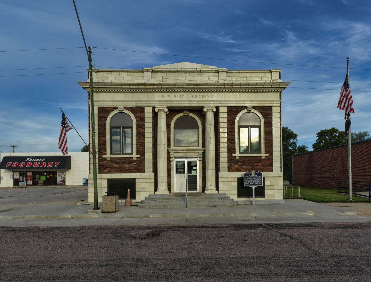 Harvard Carnegie Public Library was Built in 1915 and opened February 1916 at a cost to the town of $3,175.25 along with a donation of $6,000 by Carnegie.  It is currently used as a library.  The City Clerk's office and the Police Department are located in the lower level.