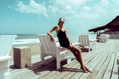 Model posing in a Beach Club in Bali