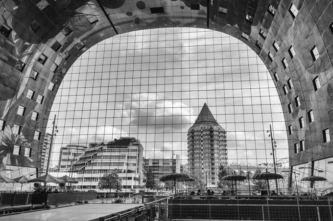 Visible trough the windows of the Markthal: Blaak tower en Rotterdam Library