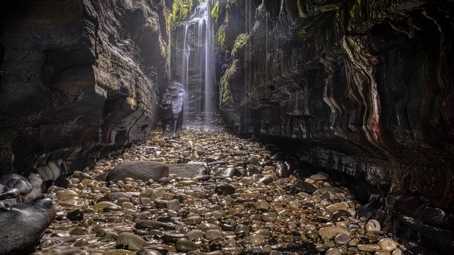 These falls in Ireland are only approachable from the beach at low tide. I went there at 05:45 wi...