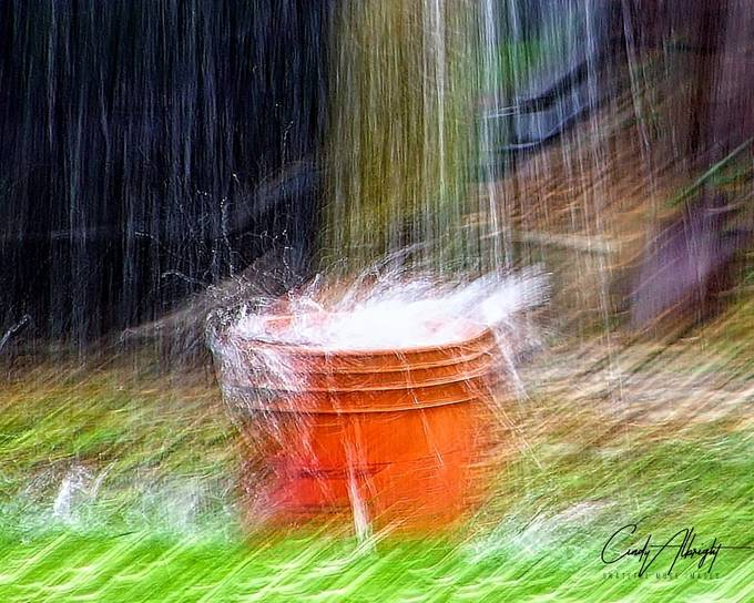 A torrential downpour fills a bucket up in no time!