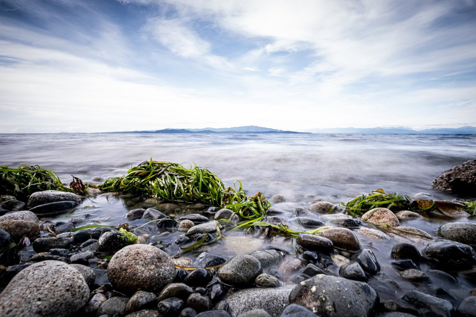 The tide gently rolls in on Rathtrevor Beach on Vancouver Island.