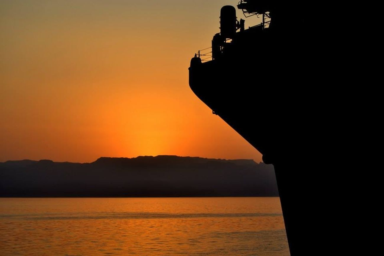 Sunset and the bow of USS Bataan (LHD 5) while moored at Amman, Jordan. (2014)