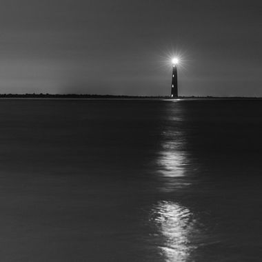 Morris Island Lighthouse off the coast of Folly Beach, South Carolina. This is a non-functioning lighthouse. It is lite a few times a year. Tonights lighting was for the Founder & owner of Hall's Chop House who past away earlier in the week.