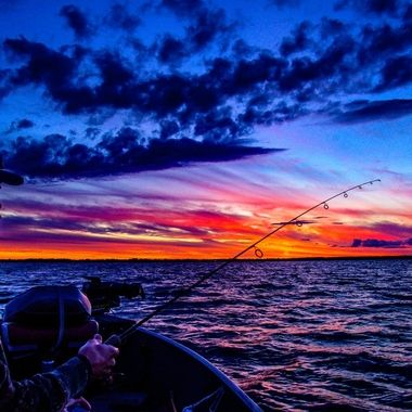 Watching a beautiful Sand Bay sunset on Rainy Lake while fishing
