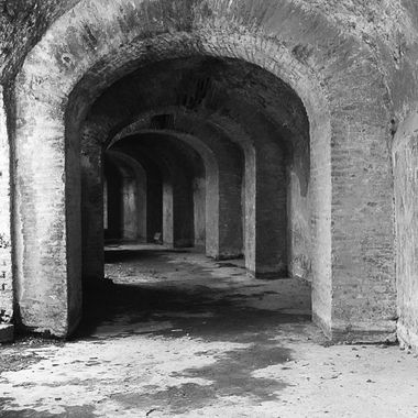 A black and white shot of a tunnel underneath the Colosseum in Pompeii