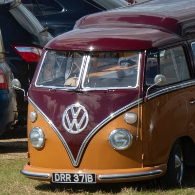 The VW camper van with the statue on the dashboard.
