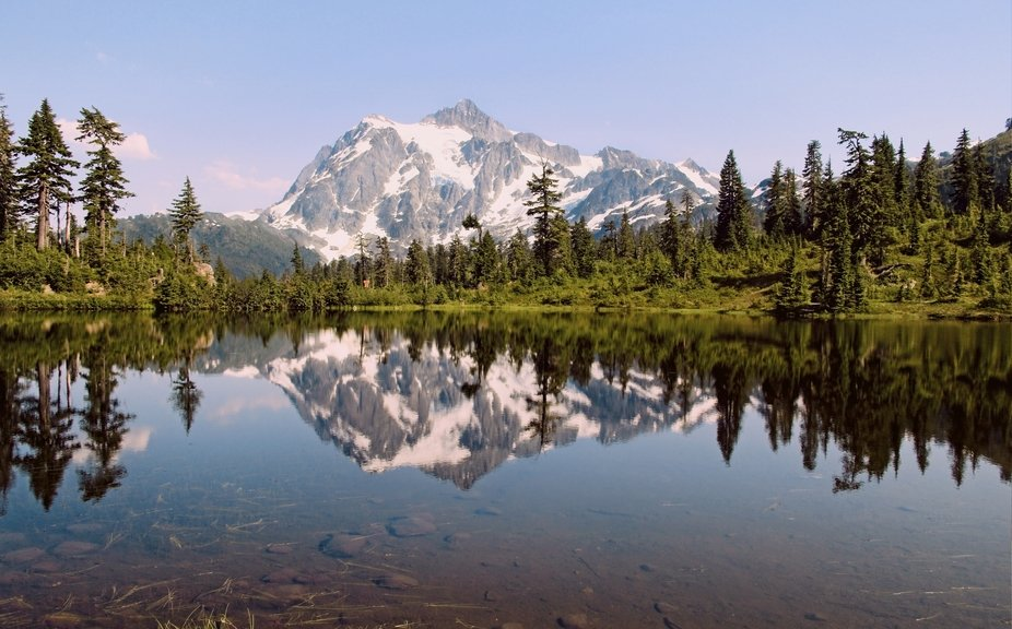 Mt Shuksan reflected in Picture Lake at the Mt Baker Ski Area. Early evening on a perfect day high in the mountains.