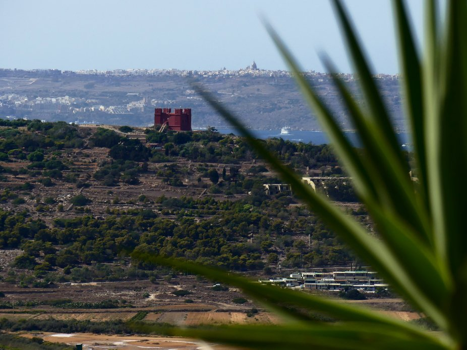 View from Mellieha towards The Red Tower with  Xewkija (Ghawdex/Gozo) in the distance.