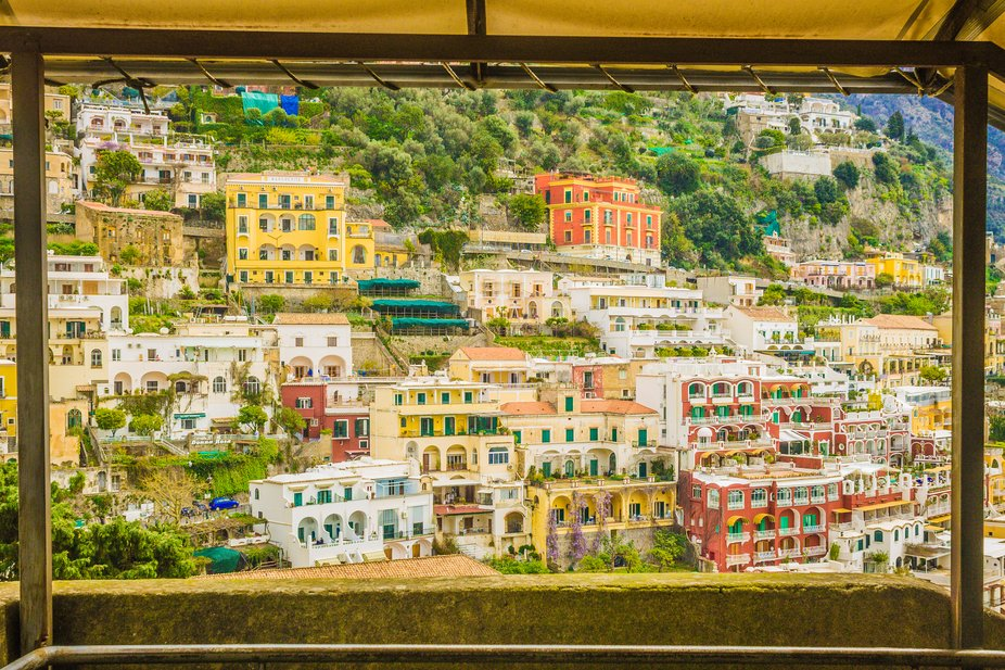 Framed shot  of the hillside houses in Positano