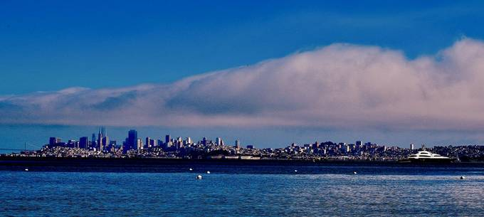 Cloudy cityscape across the SF bay with the skyline marine layers stsined by smoke during the recent wild fires burning in several areas.    This view simply inspired me for personal reasons.   This was the first clear sky day in my area in weeks with lar