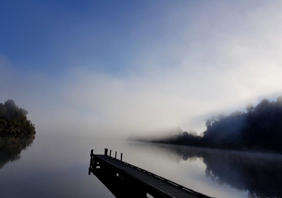 Foggy morning on the lake, on the West Coast of New Zealand