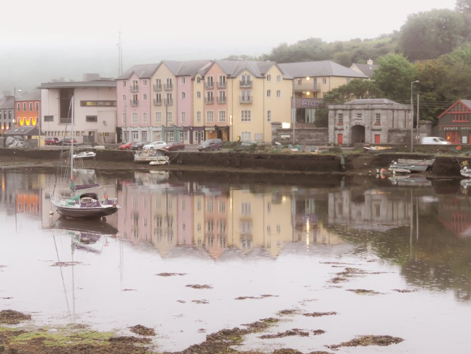 A soft, still and misty townscape