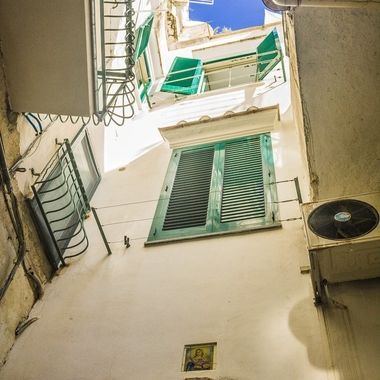 An upward shot of some windows in Amalfi