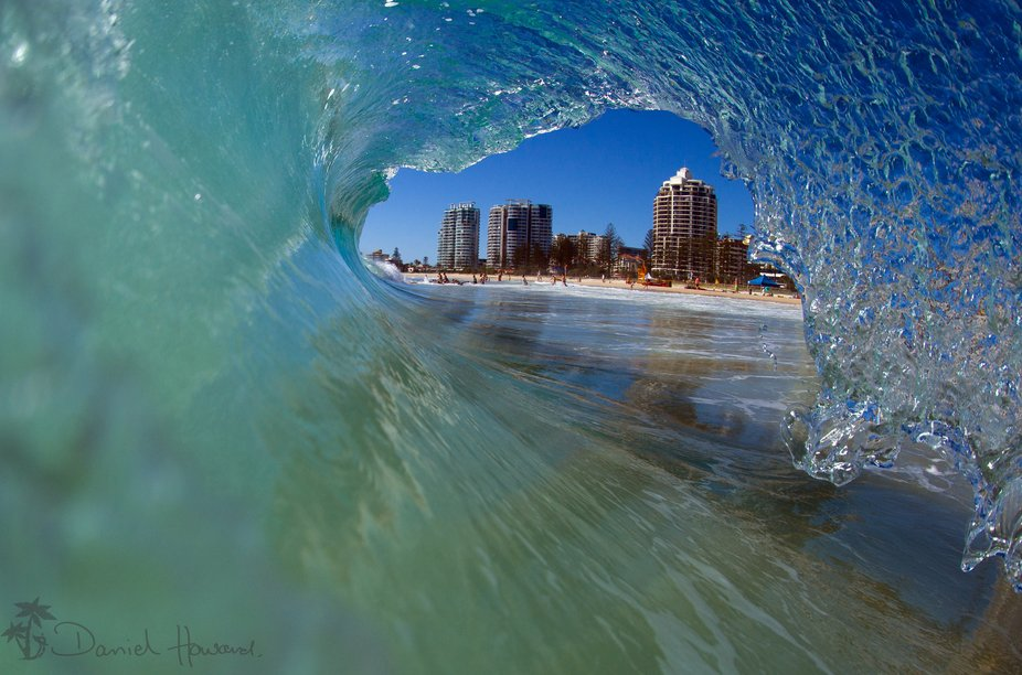 This is a water shot from within the wave looking out at Coolangatta beach, Gold Coast, Queenslan...