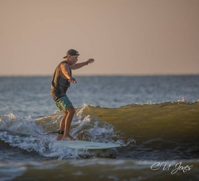 The sunrise and high tide are a great combo. I am just fascinated with the skill that it takes to surf.