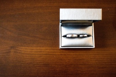 Love Wedding Rings on the Brown Wood Table