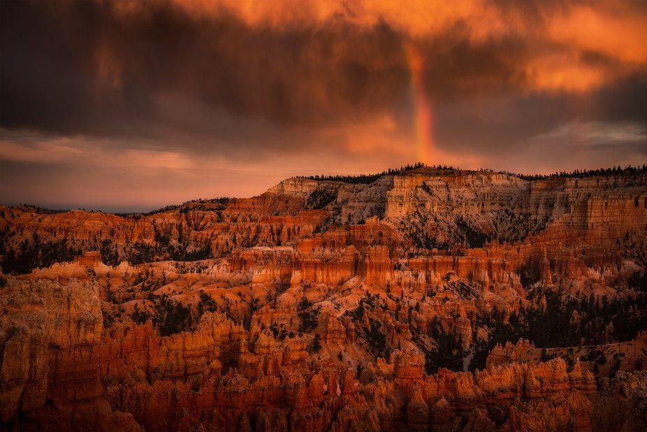Sunset storm and rainbow at Bryce Canyon