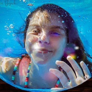 my niece underwater waving at me